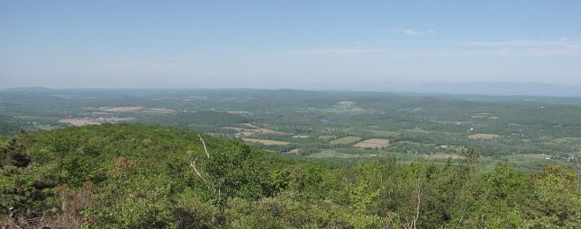 View west from Sunset Rock across the Harlem Valley of Columbia County; the  Catskills are barely visible on the horizon